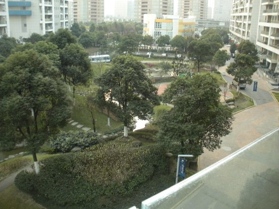 Shama Century Park Serviced Apartment: view of the green space from our balcony (winter time)