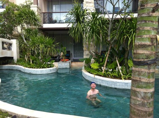sofitel bali nusa dua beach resort pool access a canal connects our hotel room to swimming po. Black Bedroom Furniture Sets. Home Design Ideas