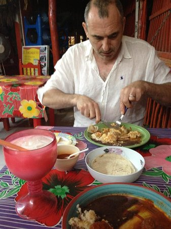 El Tacoqueto: chicken mole and albondigas, with Horchata in the big red glass