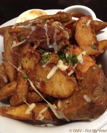 Maloney's Hotel: Potato Wedges $8.50 (w/ melted cheese, bacon bits, chives and sour cream