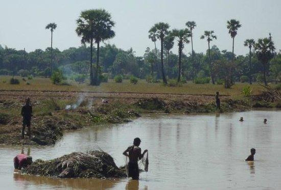 Khmer Ways - Moto Adventures Day Tours: Men in water