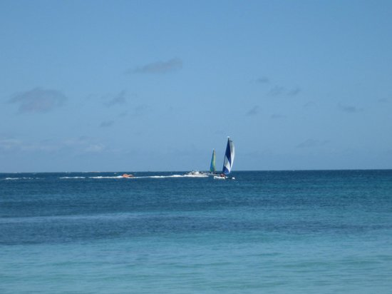 Curtain Bluff Resort: some sailboats just outside the cove style beach area