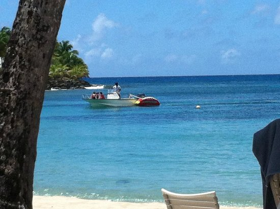 Curtain Bluff Resort: Resort boat pulling a tube