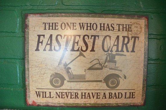 Mulligans Pub: Fastest Cart sign