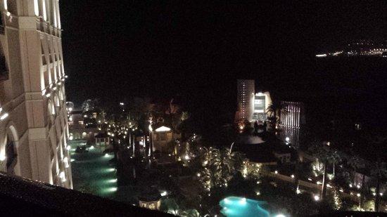 Monte-Carlo Bay & Resort : Std rm view, backside of hotel - night