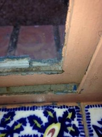 Lodge on the Desert: peeling paint and window that didn't close; representative of other windows in the room