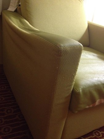 TownePlace Suites Houston Northwest: chair w/ broken armrest and torn fabric