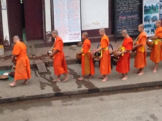 Luang Prabang Bakery Guesthouse: early morning monks accepting alms in the main street