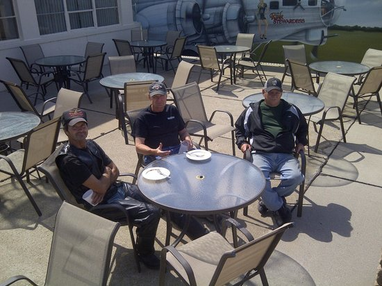 Barnstormers: Patio Seating with WWII Mural in background