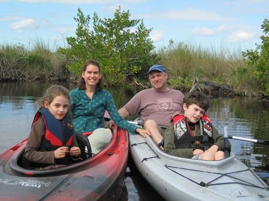 Tour the Glades: Family photo with alligators on the banks behind us