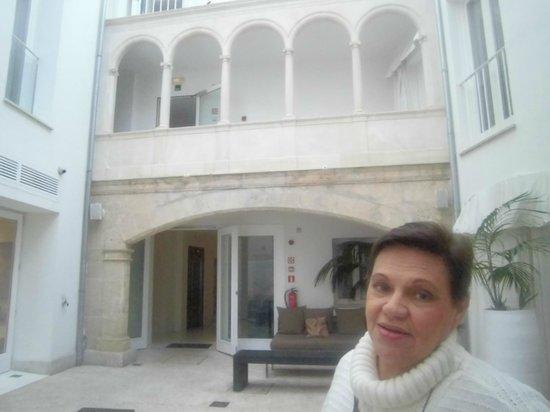 Puro Hotel : pateo interno com arcadas