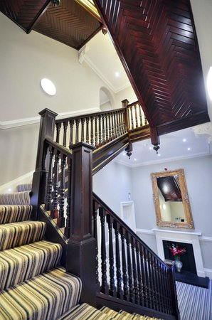 Palmerston Suites: Staircase leading up to the rooms