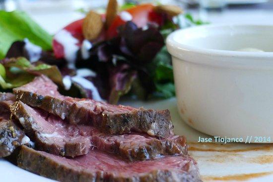 Seasonal Tastes : Seared beef with a side salad and paneer korma.
