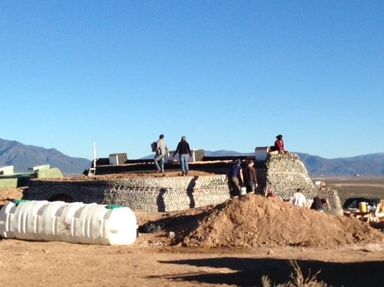Earthship Biotecture : a lot of bottles make up a building