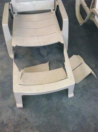 Days Inn Savannah -  Abercorn Southside: Lawn Chair by broken Pool