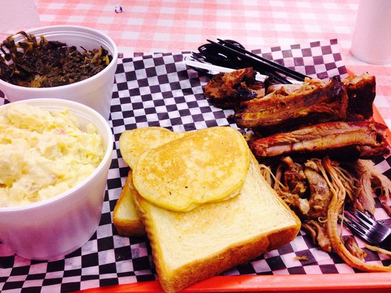 Tom's Blue Moon BBQ: Sampler for 2 people. I got the potato salad and turnip greens for sides. I'd try the slaw next