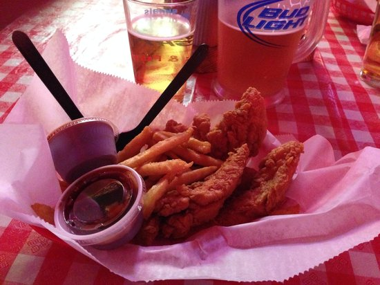 Champy's Chicken : Fried chicken tenders with BBQ dipping sauce and a pitcher of Coors Light.