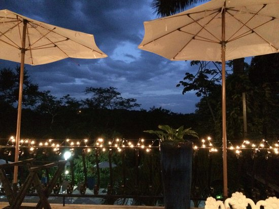 San Ignacio Resort Hotel: View from patio at night