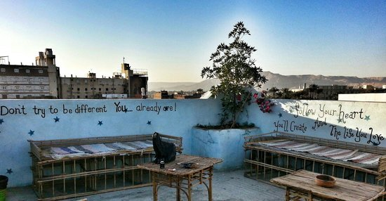 Bob Marley House Hostel: I asked the owner if I could paint some of my favorite quotes on the rooftop and he said of cour