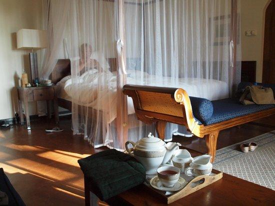 Ceylon Tea Trails : Madame enjoying 'bed tea' while the butler draws the bath