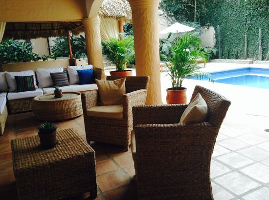 Casa Lucia Boutique Hotel & Yoga Retreat: Covered Terrace Seating & Pool Views
