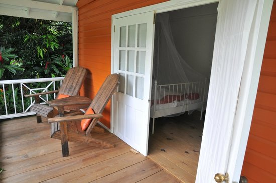 Mermaid's Secret - Riverside Retreat : The Carib Cabin's deck and bed
