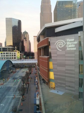 HYATT house Charlotte Center City: View from headboard showing Time Warner Arena & EpicCenter Rm 802