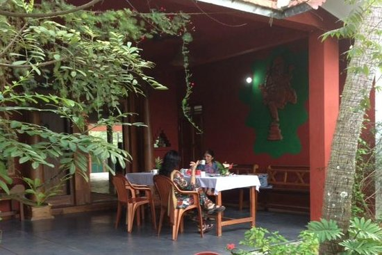 Shravanam Greens : Relaxing after breakfast on the patio