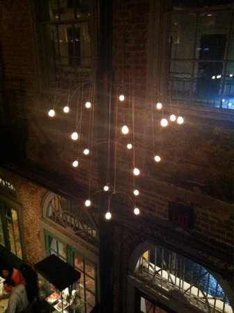 Nola Restaurant: Our view from the 2nd floor, the chandelier at the entrance