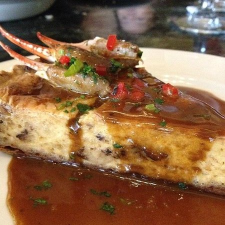 Palace Cafe: Crabmeat Cheesecake - A Palace Café signature dish! Baked in a pecan crust with a wild mushroom