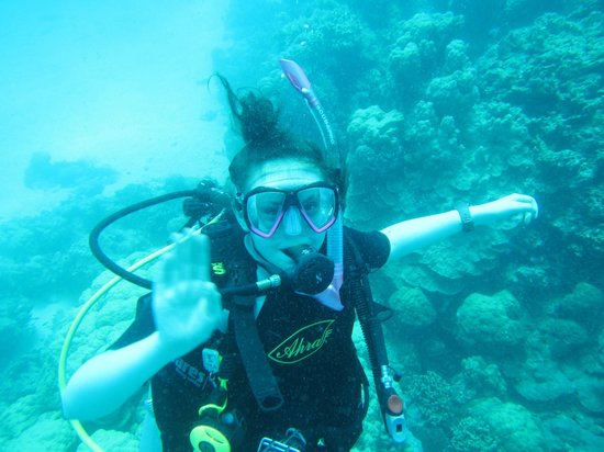 Big Blue Scuba Diving: Jess waiving her Dad of as he uses up all his air again