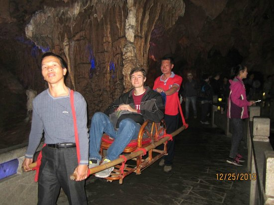 Yangshuo Private Tour-Day Tour: Alex sampling my chair ride through Silver Cave