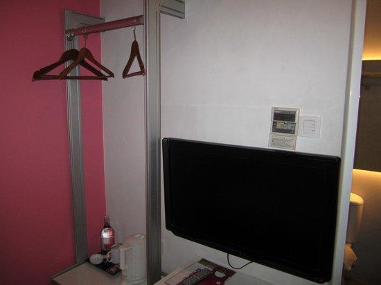 J Hotel: Makeshift wardrobe and TV