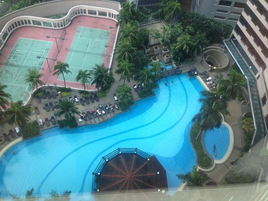 View from room of swimming pool and tennis courts - Best hotel swimming pool in kuala lumpur ...