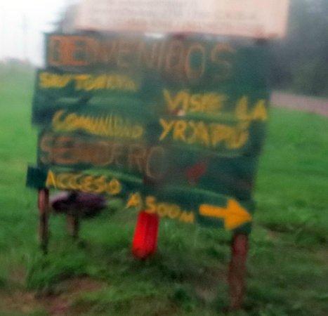Comunidad Guarani Yriapu - Comunidad Indigena Iriapu: Community signage from a wet car window