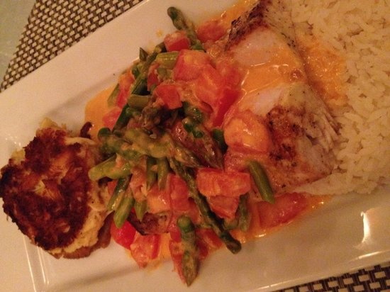 Gus' Grille: Mahi Martinique style- Grilled Mahi with jumbo crab cake ( too die for), asparagus, coconut rice