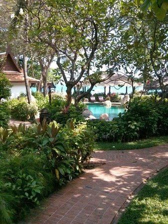 Poppies Samui: Gardens and Pool beyond