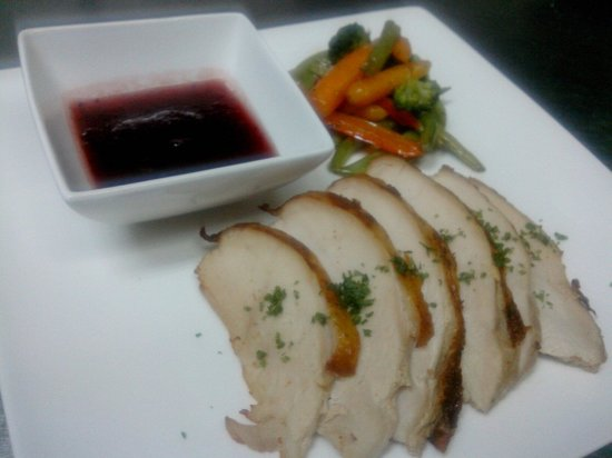 La Fuente: Roasted turkey serve with sauteed veggie and cranberry sauce