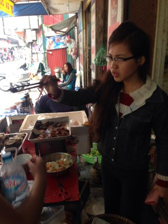 Hanoi Motorbike Street Foods - Day Tours: Ms. Moon offering bun cha