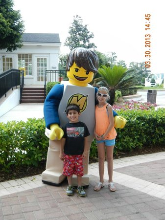LEGOLAND Florida Resort: kids posing with one of the lego figures walking around