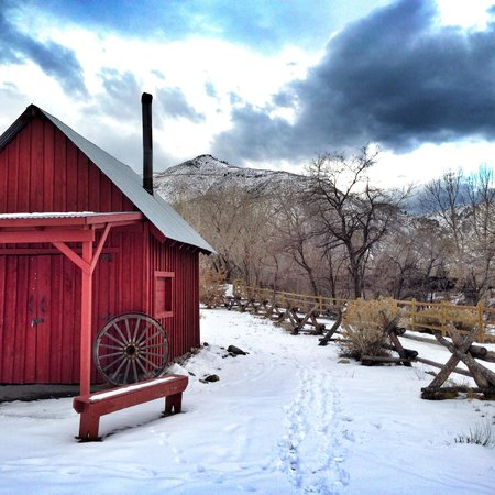 Red cabin in the snow - Picture of Golden History Museum