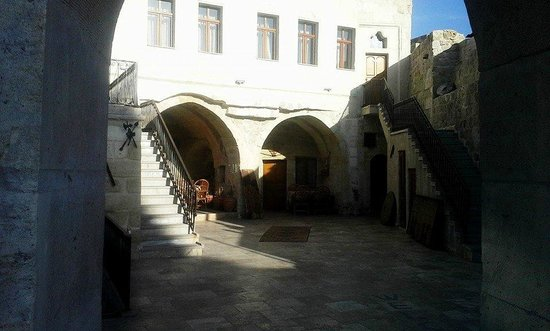 Chelebi Cave House: The view from the entrance to the courtyard.  The grounds are small, but beautiful and maintaine
