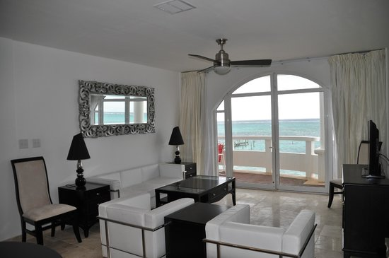 Sands Villas: Living room and wrap around balcony to ocean and pool