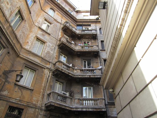 Fellini Inn Rome: Looking up at the balcony for 5th floor suite. Room below was being renovated.