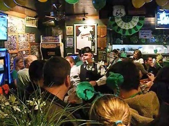 Village Tavern and Grill: Bag Piper on St. Patricks Day