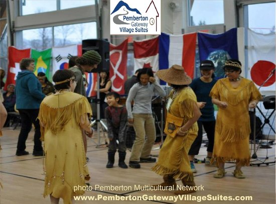 Pemberton Gateway Village Suites Hotel: Local Lil'wat dancers at MultiCultural fest & flags