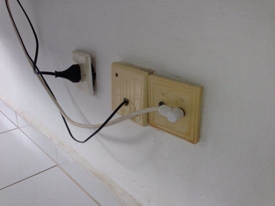 Arena Dorada Apartments: plug sockets hanging off walls