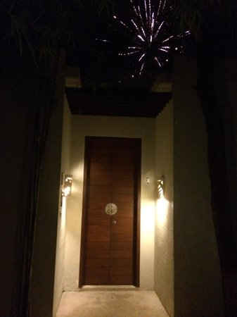 The Amala : Spa Villa Entry Door (NYE fireworks in background)