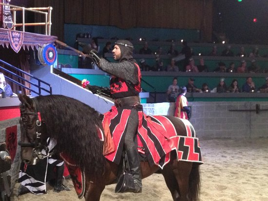 Medieval Times: The Red Knight interacting with the audience.