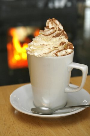 Torcross Boat House: Lovely hot chocolate with cream by the wood burner